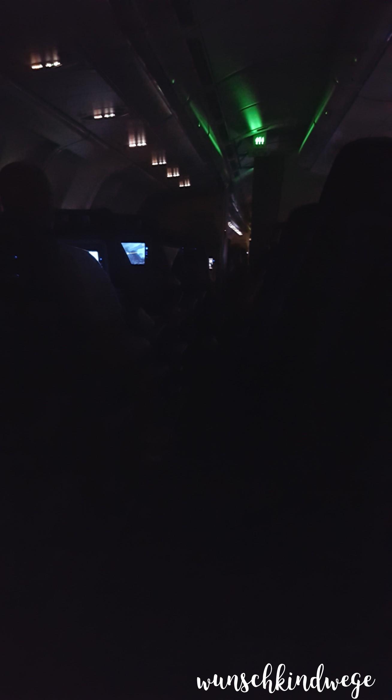 Flugzeugkabine Nacht dunkel Florida Rückflug