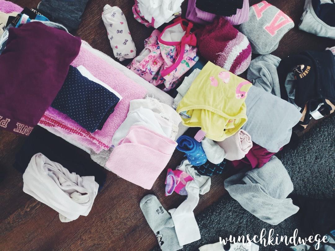 Wäsche zusammen legen
